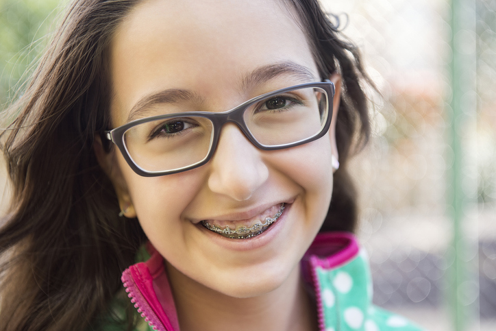 Close up portrait of a teenage girl with braces, outdoor portrait. Camera Nikon D800 36 Megapixel. Image developed from raw
